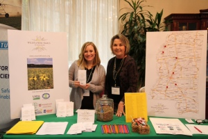 Keep Mississippi Beautiful's Neeley Norman and Sarah Kountouris tell conservationists about wildflowers at recent Mississippi Association of Conservation Districts annual meeting. Photo by Judi Craddock.